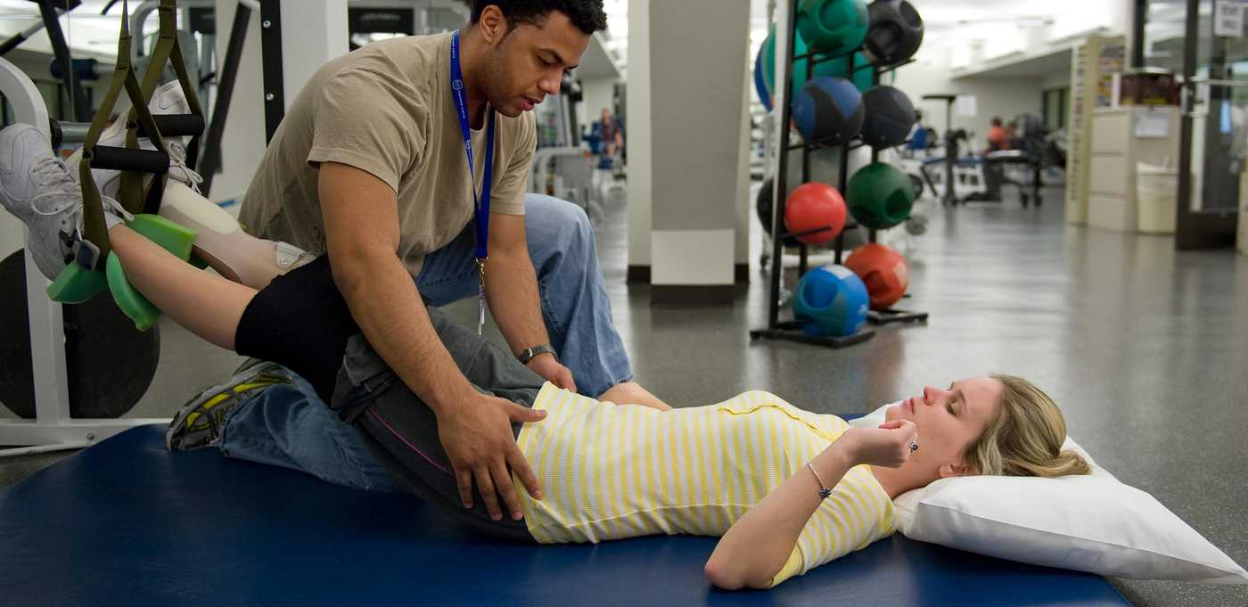 Physical Therapist helping a patient with therapy