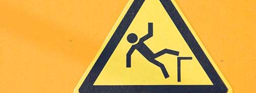 Implement safety measures to prevent falls in people with brain injury.
