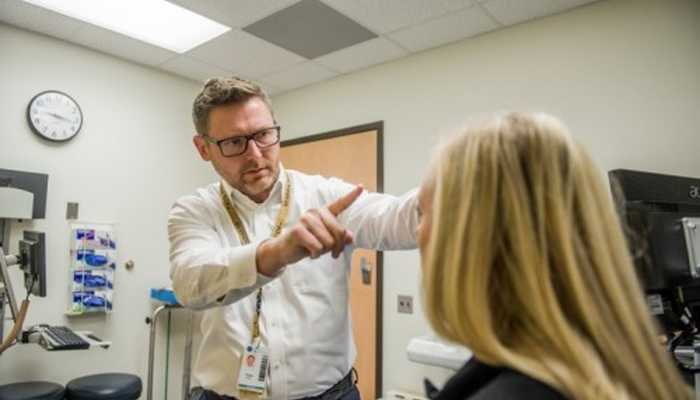 Russell Gore, M.D. , evaluates a patient in the Complex Concussion Clinic at Shepherd Center.