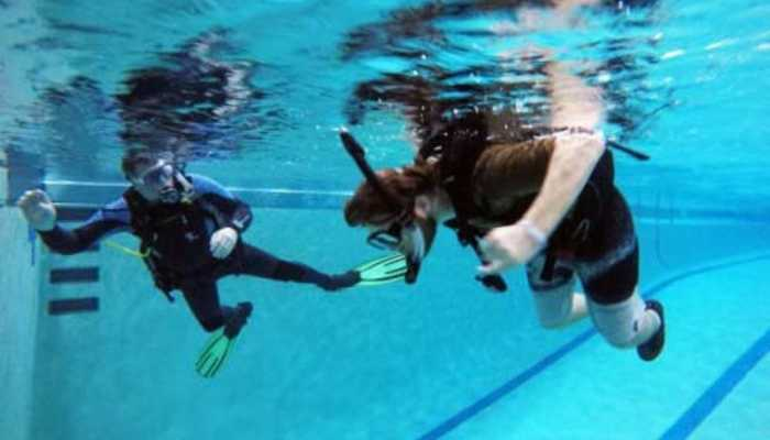 Shepherd Center patients learns to scuba dive in the hospital's pool.